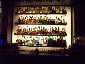 Liquor_Bottles_on_a_Bar_Wall